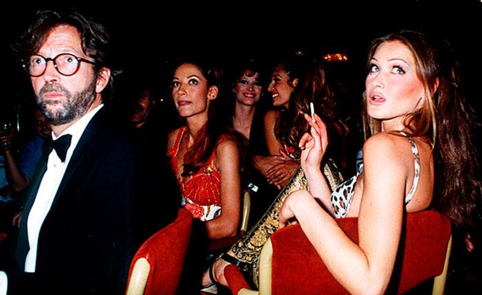 Carla Bruni, junto a Eric Clapton.