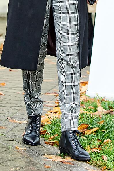 La reina Letizia desfía la lluvia con unas botas de Uterqüe