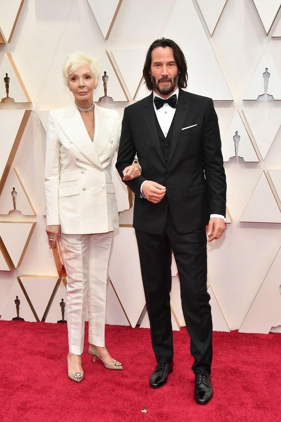 Patricia Taylor y Keanu Reeves Oscars 2020