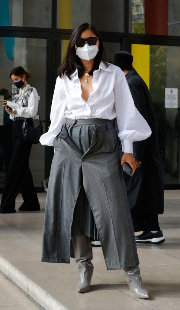 Paris Fashion Week Street Style: Woman in grey culottes, a white blouse, and a matching mask.