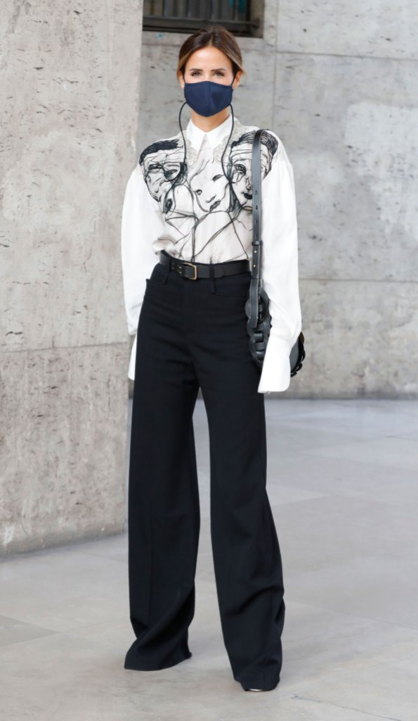Paris Fashion Week Street Style: Woman in a stylish black-and-white ensemble and a face mask.