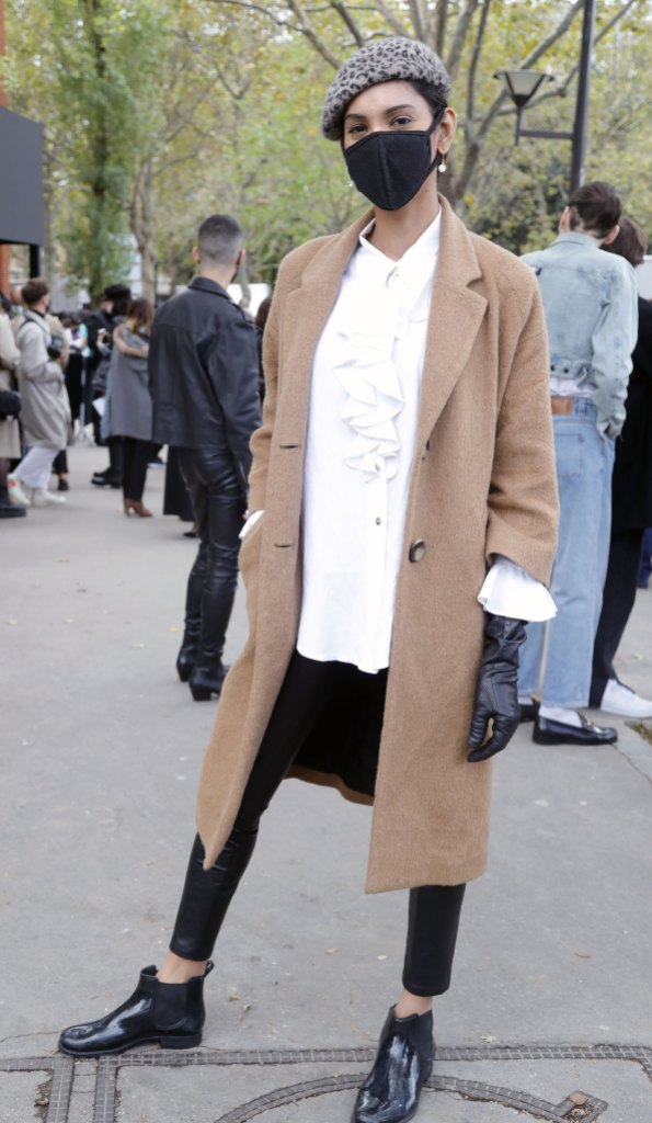 Paris Fashion Week Street Style: woman in a beret, face mask, a beige coat, and black accessories.