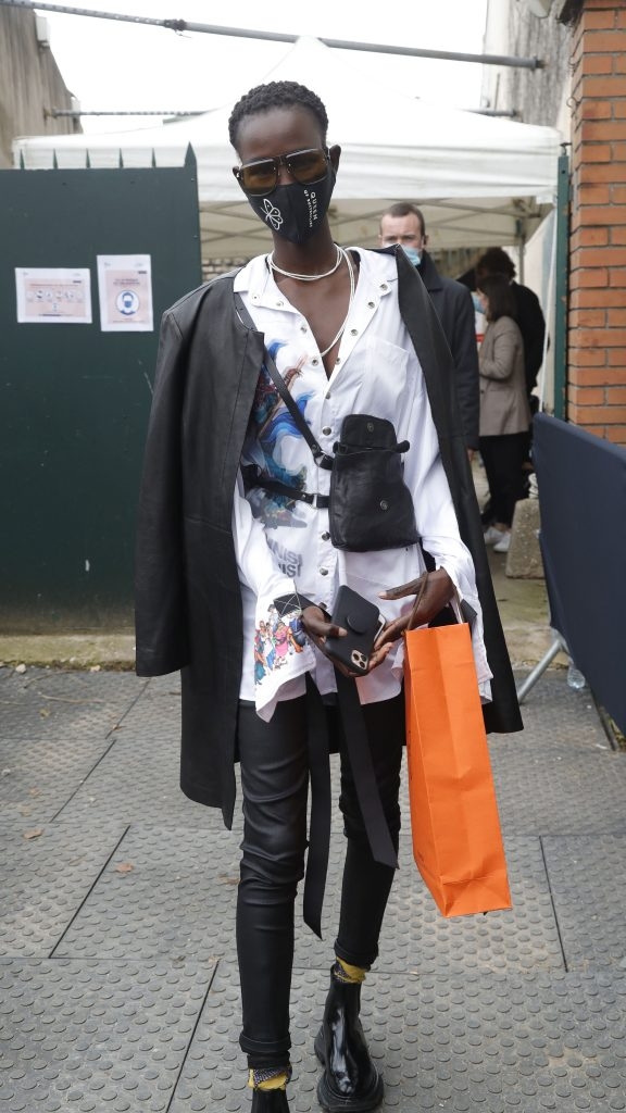 Paris Fashion Week Street Style: Woman in a mask and a black-and-white ensemble.