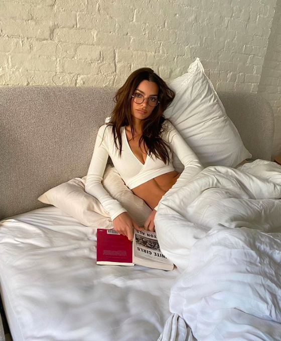 emily ratajkowski in bed with a book